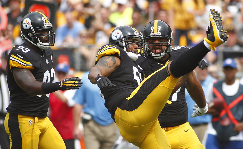. LaMarr Woodley #56 of the Pittsburgh Steelers celebrates after a sack in the first half against the Tennessee Titans during the game on September 8, 2013 at Heinz Field in Pittsburgh, Pennsylvania.  (Photo by Justin K. Aller/Getty Images)