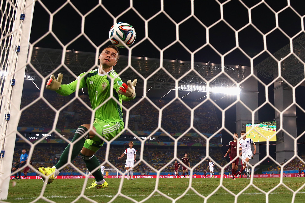 . CUIABA, BRAZIL - JUNE 17: Igor Akinfeev of Russia fails to save a shot by Lee Keun-Ho of South Korea (not pictured) for South Korea\'s first goal during the 2014 FIFA World Cup Brazil Group H match between Russia and South Korea at Arena Pantanal on June 17, 2014 in Cuiaba, Brazil.  (Photo by Warren Little/Getty Images)