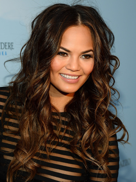. Model Chrissy Teigen arrives at Vegas Magazine\'s summer issue party at the Azure Luxury Pool at The Palazzo Las Vegas on July 24, 2013 in Las Vegas, Nevada.  (Photo by Ethan Miller/Getty Images)