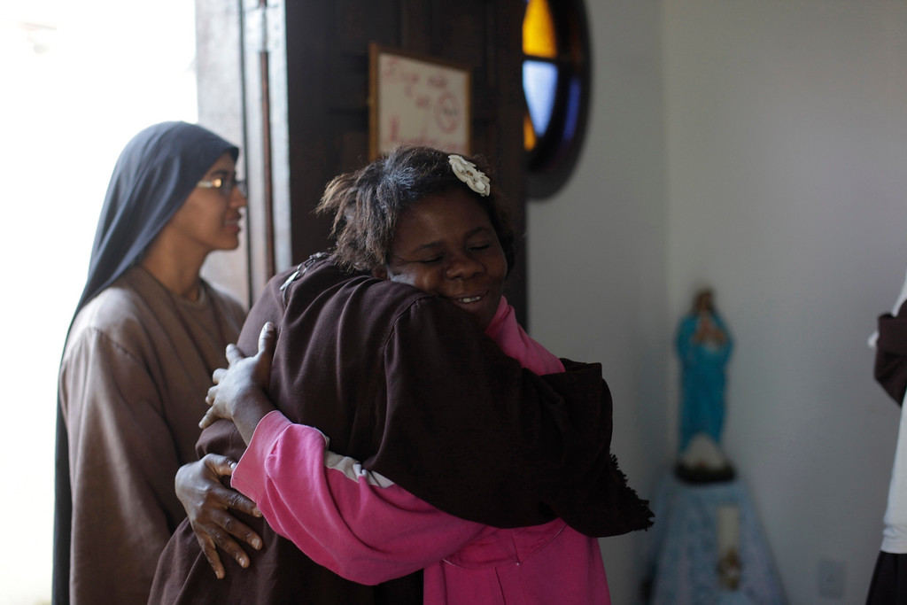 . Elaine dos Santos (R), who is homeless and lives with Franciscan fraternity O Caminho, receives a hug from a nun after an early morning prayer in the Campo Grande neighbourhood of Rio de Janeiro  April 16, 2013. O Caminho (The Way), are a group of Franciscan monks and nuns who help the homeless on the streets of Rio de Janeiro. They consider the election of Pope Francis, the first pontiff to take the name of St Francis of Assisi, to be a confirmation of their beliefs in poverty and simplicity. In July, Pope Francis will visit Rio de Janeiro in his first international trip since assuming the papacy. Picture taken April 16, 2013. REUTERS/Ricardo Moraes