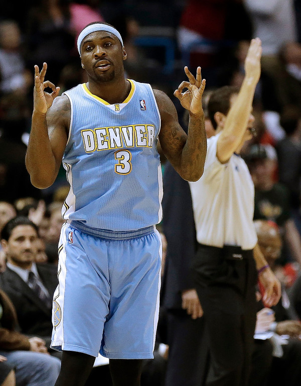 . Denver Nuggets\' Ty Lawson reacts after his three-point basket against the Milwaukee Bucks during the second half of an NBA basketball game on Monday, April 15, 2013, in Milwaukee. (AP Photo/Jeffrey Phelps)