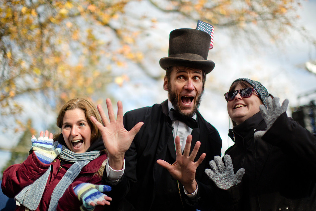 . Rick Miller, a President Abraham Lincoln re-enactor, poses for photographs after a ceremony commemorating the 150th anniversary of the dedication of the Soldiers\' National Cemetery and President Abraham Lincoln\'s Gettysburg Address, Tuesday, Nov. 19, 2013, in Gettysburg, Pa.  (AP Photo/Matt Rourke)