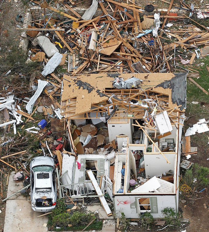 . A a roofless home is seen in Granbury, Texas on Thursday May 16, 2013.    (AP Photo/The Fort Worth Star-Telegram, Ron T. Ennis )