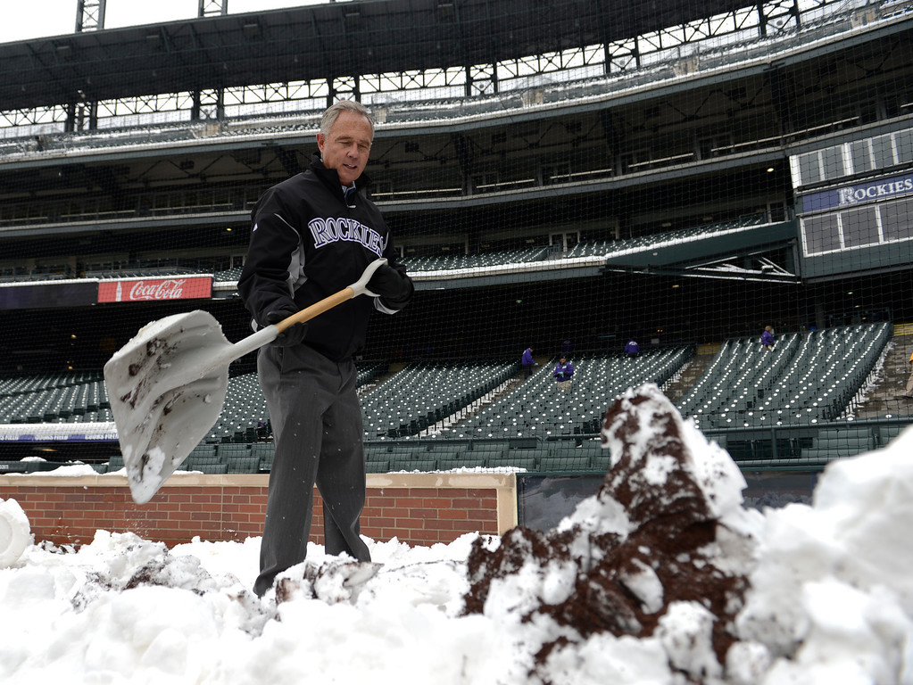 . Executive Vice President, Chief Baseball Officer/General Manger Dan O\'Dowd helps out shoveling snow from right field. Rockies grounds crew and employees work to clear the field of snow to get the first game of a double header in against the  New York Mets April 16, 2013 at Coors Field. (Photo By John Leyba/The Denver Post)