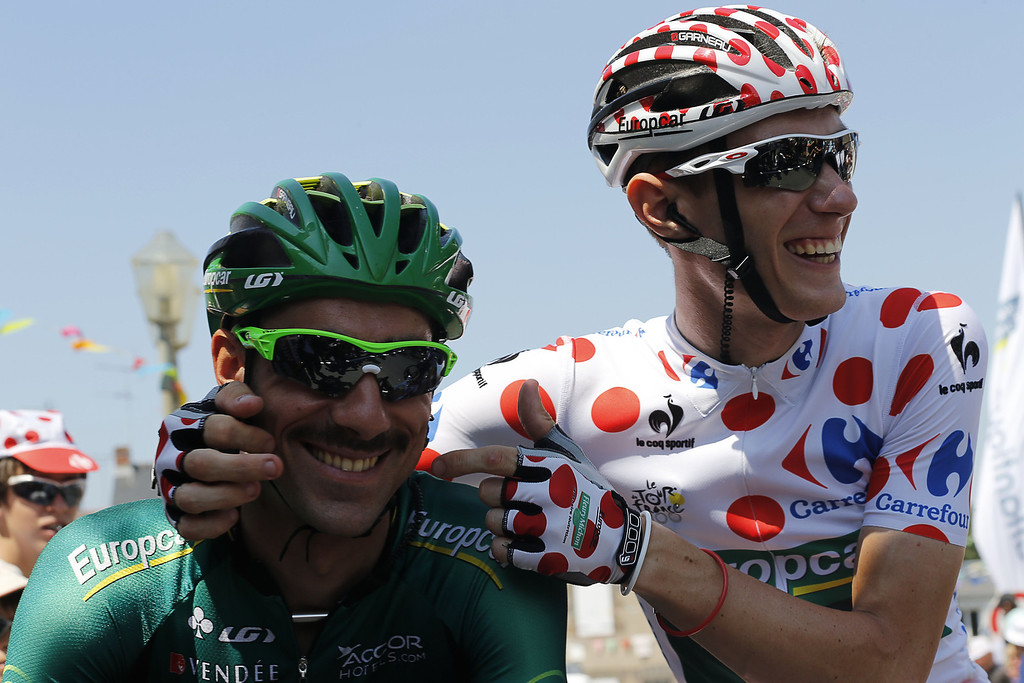 . Best climber\'s polka dot jersey France\'s Pierre Rolland (R) jokes with France\'s Jerome Cousin in Saint-Gildas-des-Bois at the departure village before the start of the 197 km tenth stage of the 100th edition of the Tour de France cycling race on July 9, 2013 between Saint-Gildas-des-Bois and Saint-Malo, northwestern France.   PASCAL GUYOT/AFP/Getty Images