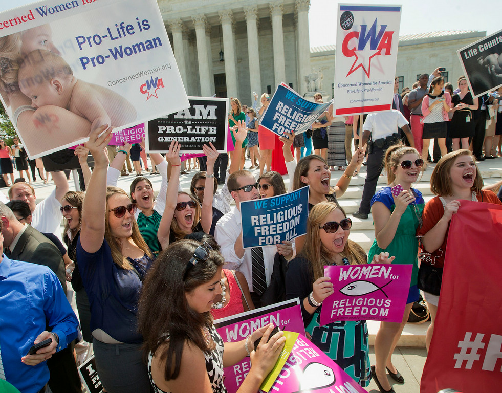 . Demonstrator react to hearing the Supreme Court\'s decision on the Hobby Lobby case outside the Supreme Court in Washington, Monday, June 30, 2014. (AP Photo/Pablo Martinez Monsivais)