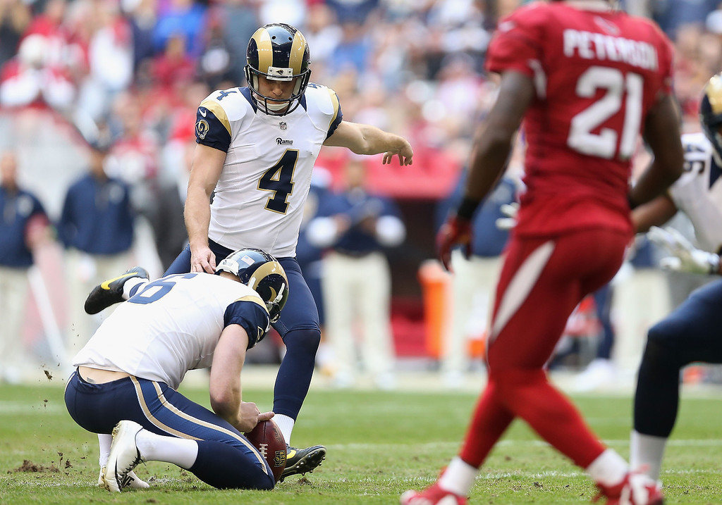 . Kicker Greg Zuerlein #4 of the St. Louis Rams kicks a 44 yard field goal against the Arizona Cardinals during the first quarter of the NFL game at the University of Phoenix Stadium on December 8, 2013 in Glendale, Arizona.  (Photo by Christian Petersen/Getty Images)