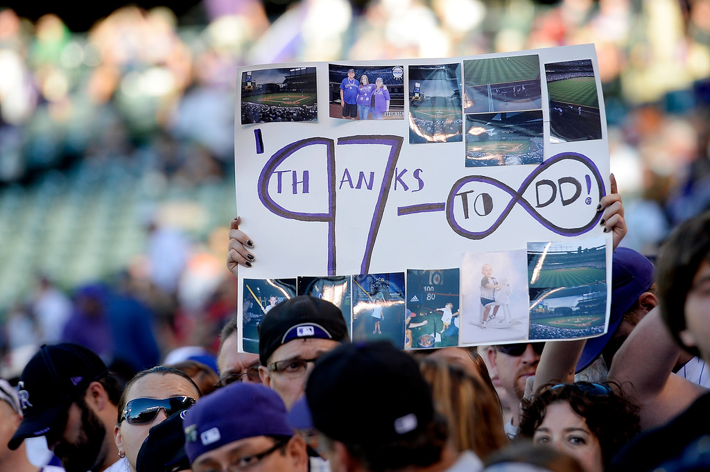 . A fan holds a sign paying homage to Todd Helton before the start of action in Denver. The Colorado Rockies hosted the Boston Red Sox and said farewell to longtime first baseman Todd Helton, who recently announced his retirement following this season. (Photo by John Leyba/The Denver Post)