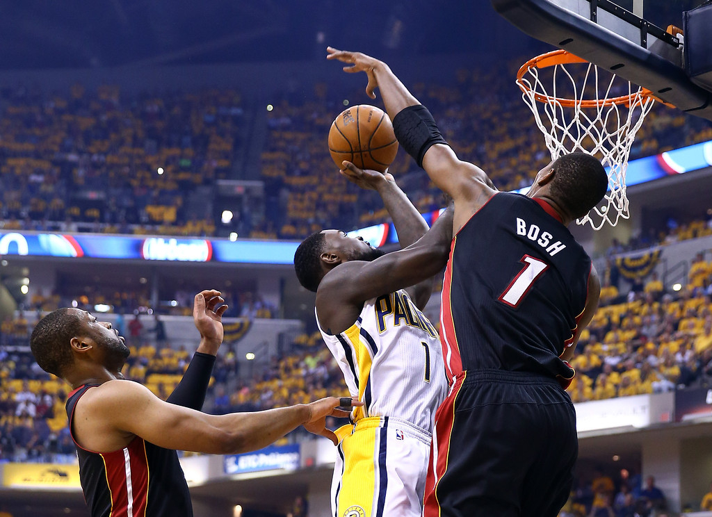. INDIANAPOLIS, IN - MAY 28: Lance Stephenson #1 of the Indiana Pacers goes up for a shot as Chris Bosh #1 of the Miami Heat defends during Game Five of the Eastern Conference Finals of the 2014 NBA Playoffs at Bankers Life Fieldhouse on May 28, 2014 in Indianapolis, Indiana.  (Photo by Andy Lyons/Getty Images)