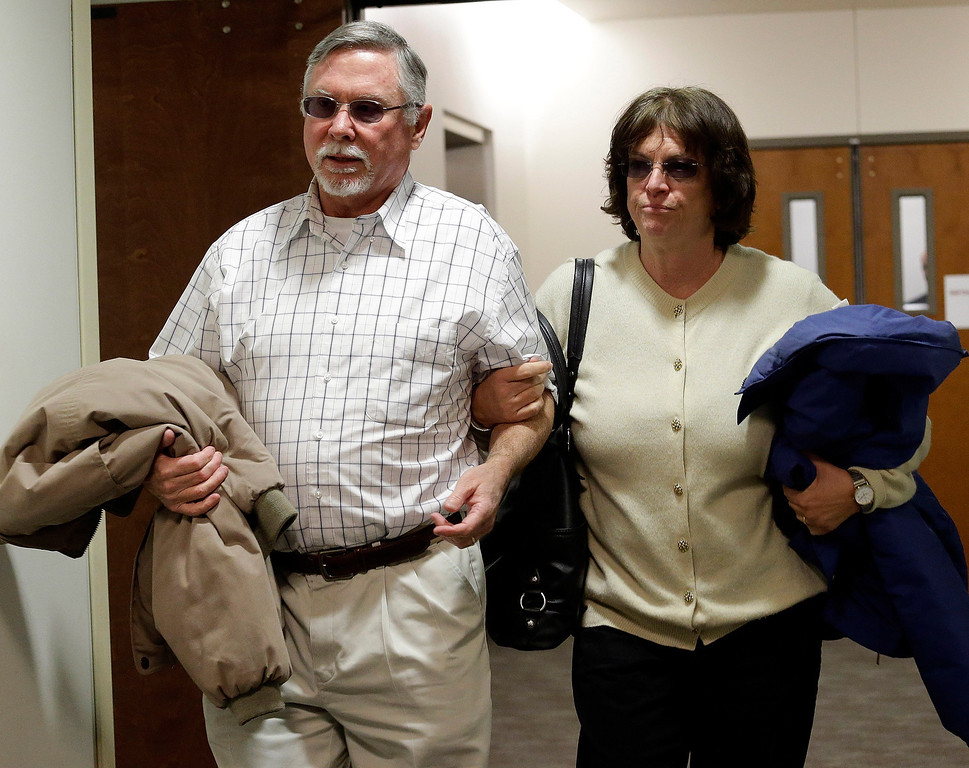 . James Holmes parents Robert and Arlene Holmes arrive at district court for the arraignment of  their son Aurora theater shooting suspect James Holmes in Centennial, Colo., on Tuesday, March 12, 2013.  (AP Photo/Ed Andrieski)