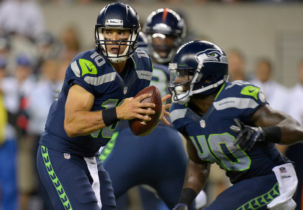 . SEATTLE, WA. - AUGUST 17: Seattle Seahawks quarterback Brady Quinn (10) scrambles out of the pocket in the fourth quarter agains the Denver Broncos August 17, 2013 at Century Link Field. (Photo By John Leyba/The Denver Post)