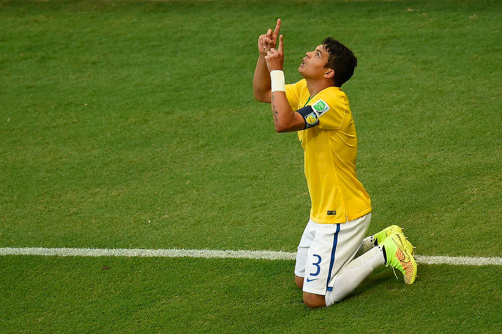 . Brazil\'s defender and captain Thiago Silva celebrates after scoring a goal during the quarter-final football match between Brazil and Colombia at the Castelao Stadium in Fortaleza during the 2014 FIFA World Cup on July 4, 2014. ODD ANDERSEN/AFP/Getty Images
