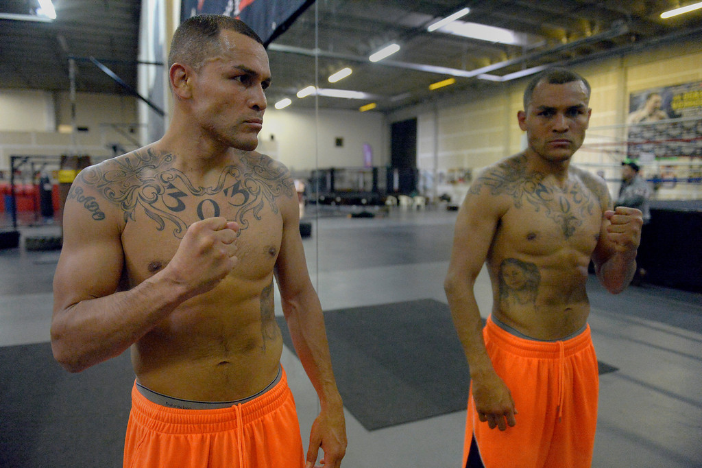 """. DENVER, CO - OCTOBER 15: Colorado\'s only reigning Champion \""""Mile High\"""" Mike Alvarado poses in the mirror after holding a media workout day at Delgado\'s Gym October 15, 2013 as he gets ready for his fight with the Russian Provodnikov at 1st Bank Center. (Photo by John Leyba/The Denver Post)"""