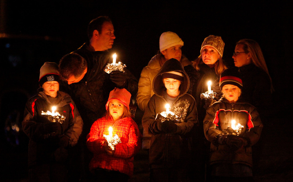 . Mourners gather for a candlelight vigil at Ram\'s Pasture to remember shooting victims, Saturday, Dec. 15, 2012 in Newtown, Conn.  A gunman walked into Sandy Hook Elementary School in Newtown Friday and opened fire, killing 26 people, including 20 children. (AP Photo/Jason DeCrow)