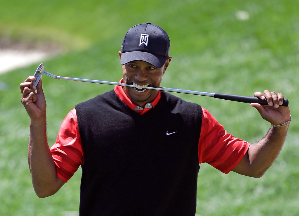 . Tiger Woods bites down on his club after missing a putt for par on the 18th green during the final round of the Arnold Palmer Invitational golf tournament, Monday, March 25, 2013, in Orlando, Fla. Woods won the tournament with a 13-under-par total. (AP Photo/John Raoux, File)