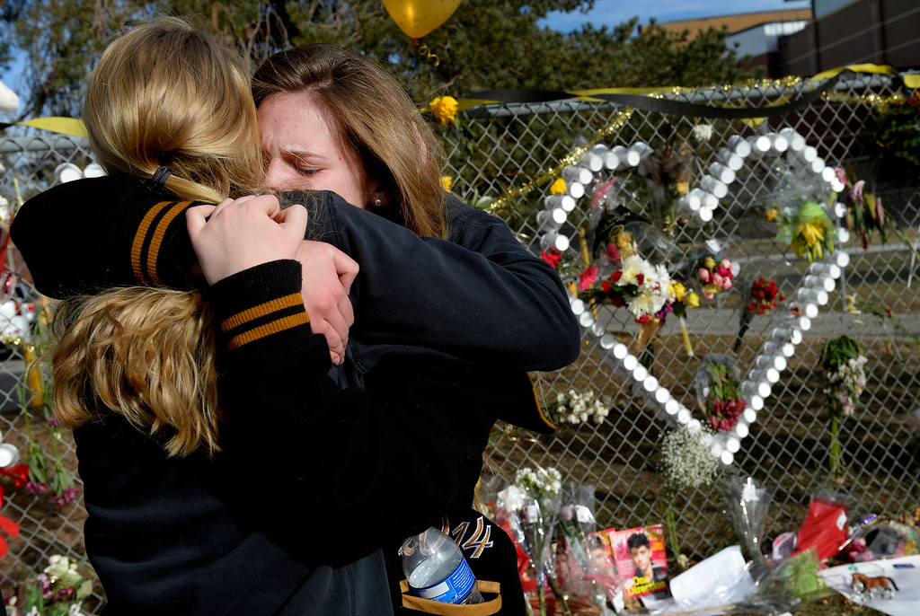 ". Senior Lily Boettcher, right, is comforted by graduate Joy Dafoe outside Arapahoe High School in Centennial, CO December 19, 2013. Seniors and Juniors returned to the school for two hour periods Thursday, Sophomores and Freshmen will return on Friday. Lily said, ""it was good to be back in the school with everybody. I love my school so much. I couldn\'t ask for a better community. The victim from Friday�s shooting at Arapahoe High School, Claire Davis, 17, remains in critical condition. She was shot on Friday when classmate Karl Pierson opened fire in the school. The gunman died from a self-inflicted gunshot wound. (Photo By Craig F. Walker / The Denver Post)"