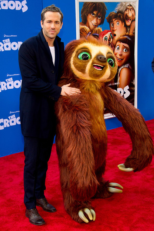 """. Ryan Reynolds poses with Belt the sloth at \""""The Croods\"""" premiere on Sunday, March 10, 2013 in New York. (Photo by Charles Sykes/Invision/AP)"""