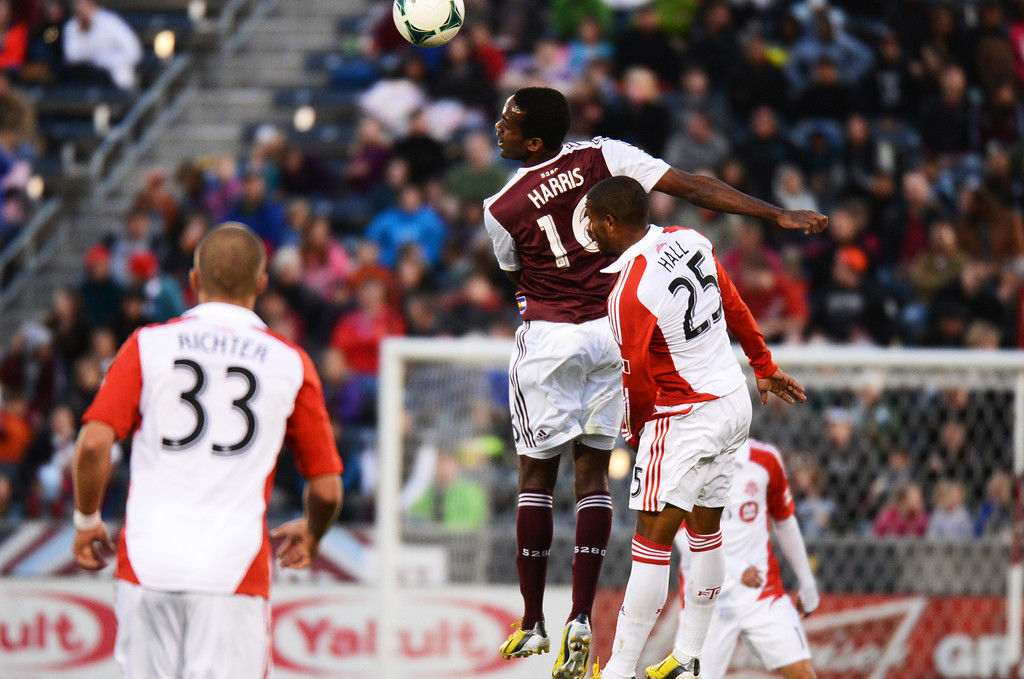 . COMMERCE CITY, CO. - MAY 04 : Atiba Harris #16 of Colorado Rapids header over Jeremy Hall #25 of Toronto FC by Ryan Richter #33 of Toronto FC  at Dick\'s Sporting Goods Park in Commerce City, Colorado. May 4, 2013. (Photo By Hyoung Chang/The Denver Post)