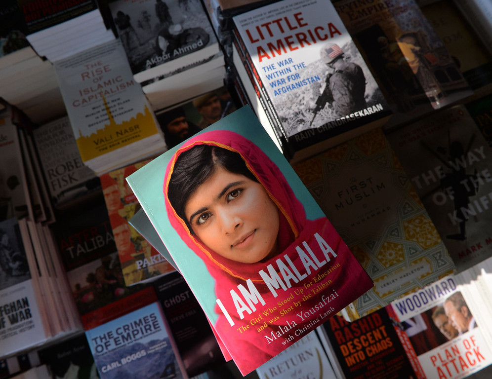". A copy of the memoirs of Pakistani child activist Malala Yousafzai is pictured in a bookstore in Islamabad on October 8, 2013. Pakistani schoolgirl Malala Yousafzai tells of the moment she was shot by the Taliban for campaigning for girls\' education in her new autobiography out on October 8, amid speculation that she may be about to become the youngest ever winner of the Nobel Peace Prize. Co-written with British journalist Christina Lamb, ""I Am Malala: The Girl Who Stood Up for Education and was Shot by the Taliban\"" tells of the 16-year-old\'s terror as two gunmen boarded her schoolbus on October 9, 2012 and shot her in the head.   AAMIR QURESHI/AFP/Getty Images"