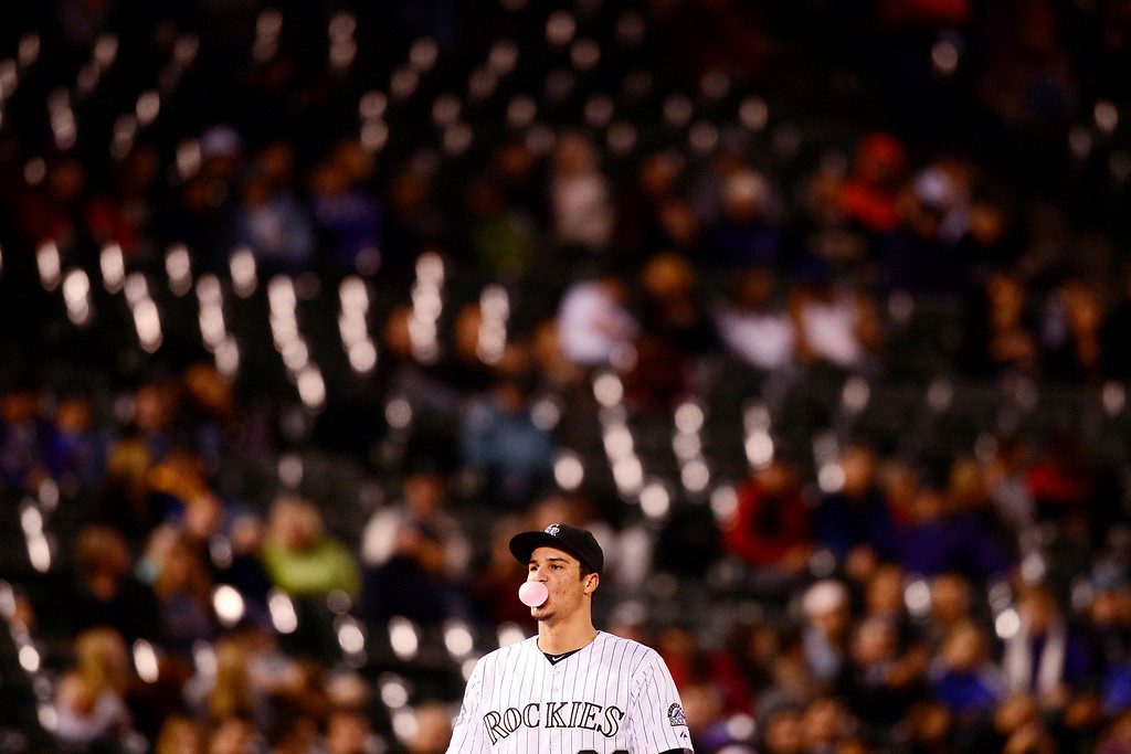 . Colorado Rockies third baseman Nolan Arenado (28) works on a bubble while playing against the Houston Astros on May 30, 2013, at Coors Field in Denver. (Photo by AAron Ontiveroz/The Denver Post)