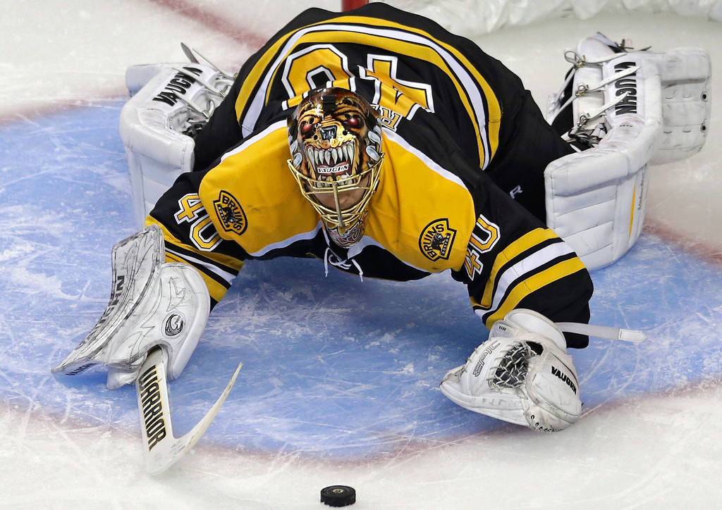 . Boston Bruins goalie Tuukka Rask drops to the ice for the puck, against the Pittsburgh Penguins during the second period in Game 3 of the NHL hockey Stanley Cup playoffs Eastern Conference finals, in Boston on Wednesday, June 5, 2013. (AP Photo/Charles Krupa)