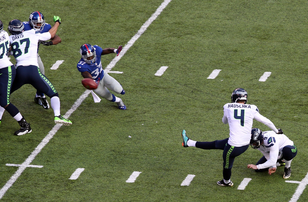 . Seattle Seahawks kicker Steven Hauschka (4), with Jon Ryan holding, kicks a field goal against the New York Giants during the first half of an NFL football game, Sunday, Dec. 15, 2013, in East Rutherford, N.J. (AP Photo/Peter Morgan)