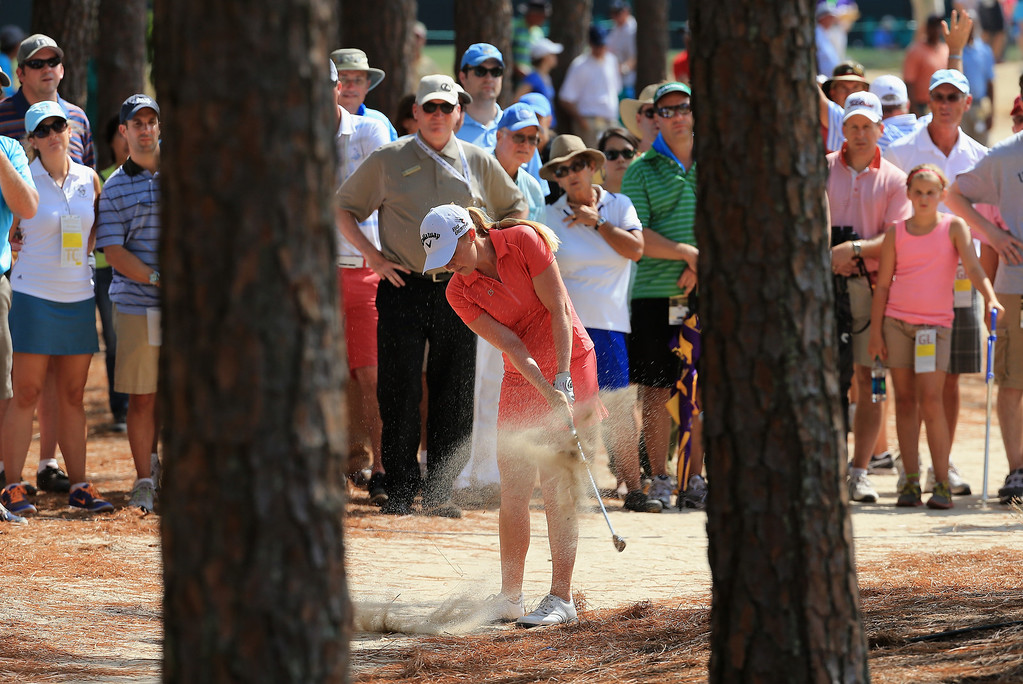 . Stephanie Meadow of Northern Ireland plays a shot on the from the pine straw on the 12th hole during the final round of the 69th U.S. Women\'s Open at Pinehurst Resort & Country Club, Course No. 2 on June 22, 2014 in Pinehurst, North Carolina.  (Photo by David Cannon/Getty Images)