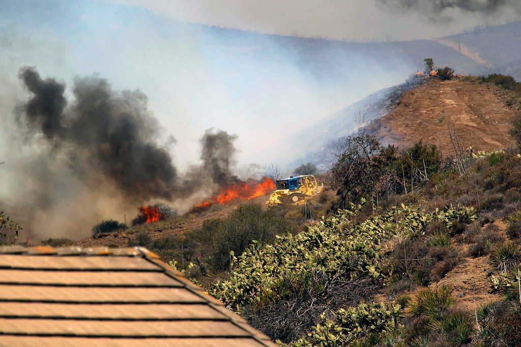 . A bulldozer helps clear a hill near a fire in Thousand Oaks, Calif. on Thursday, May 2, 2013. (AP Photo/Nick Ut)