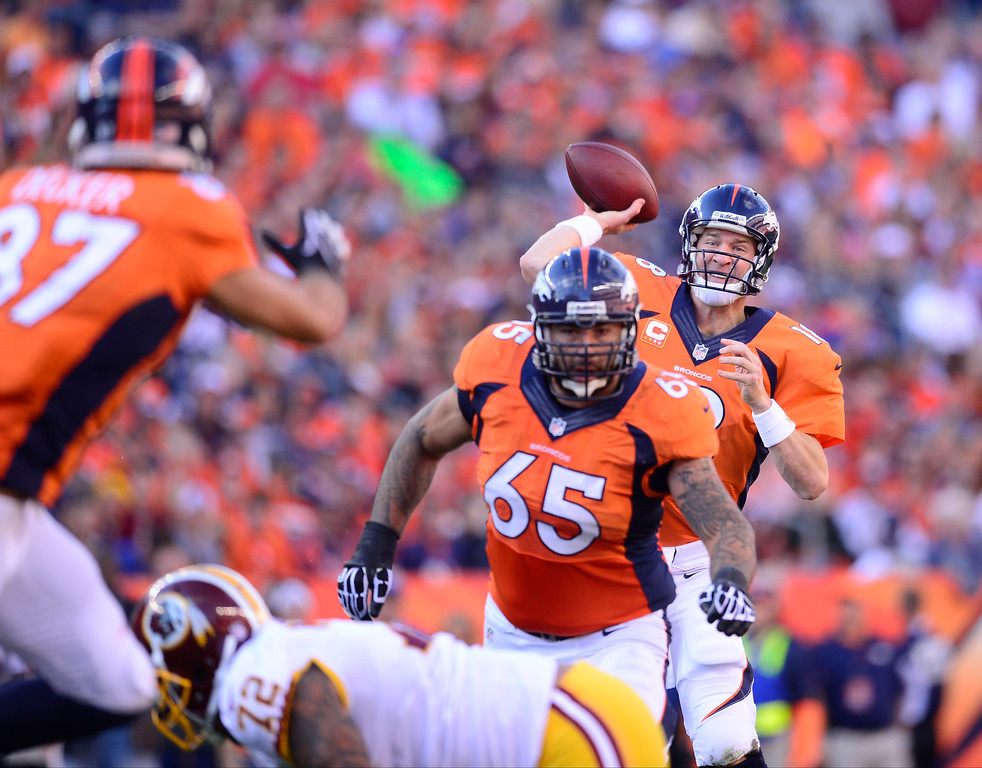 . Denver Broncos quarterback Peyton Manning (18) makes a pass in the third quarter.  (Photo by AAron Ontiveroz/The Denver Post)