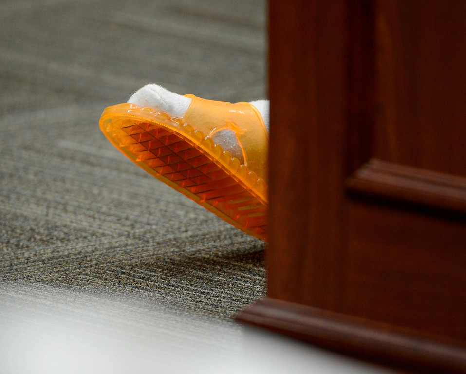 . The foot of Aurora theater shooting suspect James Holmes is pictured during a court hearing in Centennial, Colo., on Tuesday, June 4, 2013.  Judge Carlos A Samour Jr. accepted  plea of not guilty by reason of insanity from Holmes.  He also ruled that prosecutors can have access to a notebook Holmes sent to a psychiatrist before last summer\'s rampage. (AP Photo/The Denver Post, Andy Cross, Pool)