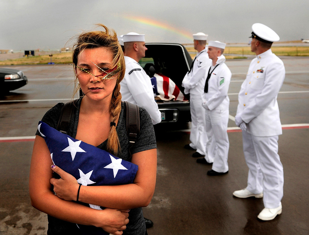 . Chantel Blunk, wife of Jonathan Blunk, waits on the tarmac at Denver International Airport as her husband\'s body is prepared to be flown to Reno, Nevada for his full military funeral. Blunk, a five-year U.S. Navy veteran, was killed when James Holmes opened fire at a crowded movie theater.