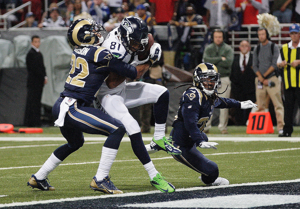 . Seattle Seahawks wide receiver Golden Tate (81) makes a touch-down catch against St. Louis Rams cornerback Trumaine Johnson (22) during the first half of an NFL football game, Monday, Oct. 28, 2013, in St. Louis. (AP Photo/Tom Gannam)