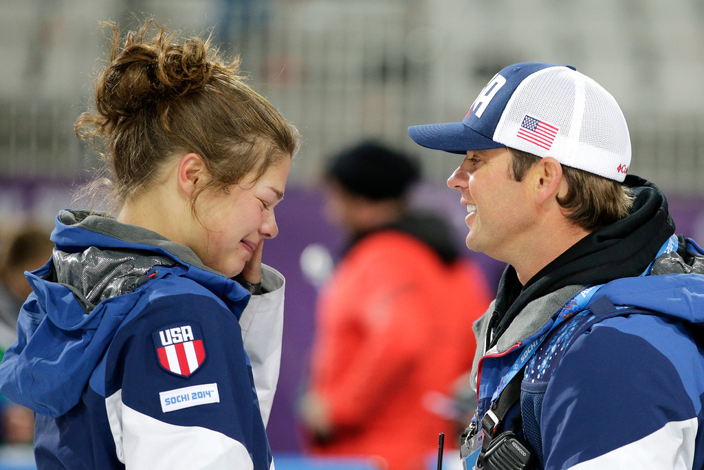 . United States\' Ashley Caldwell, left, is comforted by head aerial coach Todd Ossian after the women\'s freestyle skiing aerials final at the Rosa Khutor Extreme Park, at the 2014 Winter Olympics, Friday, Feb. 14, 2014, in Krasnaya Polyana, Russia. Caldwell was eliminated after the final 1. (AP Photo/Jae C. Hong)