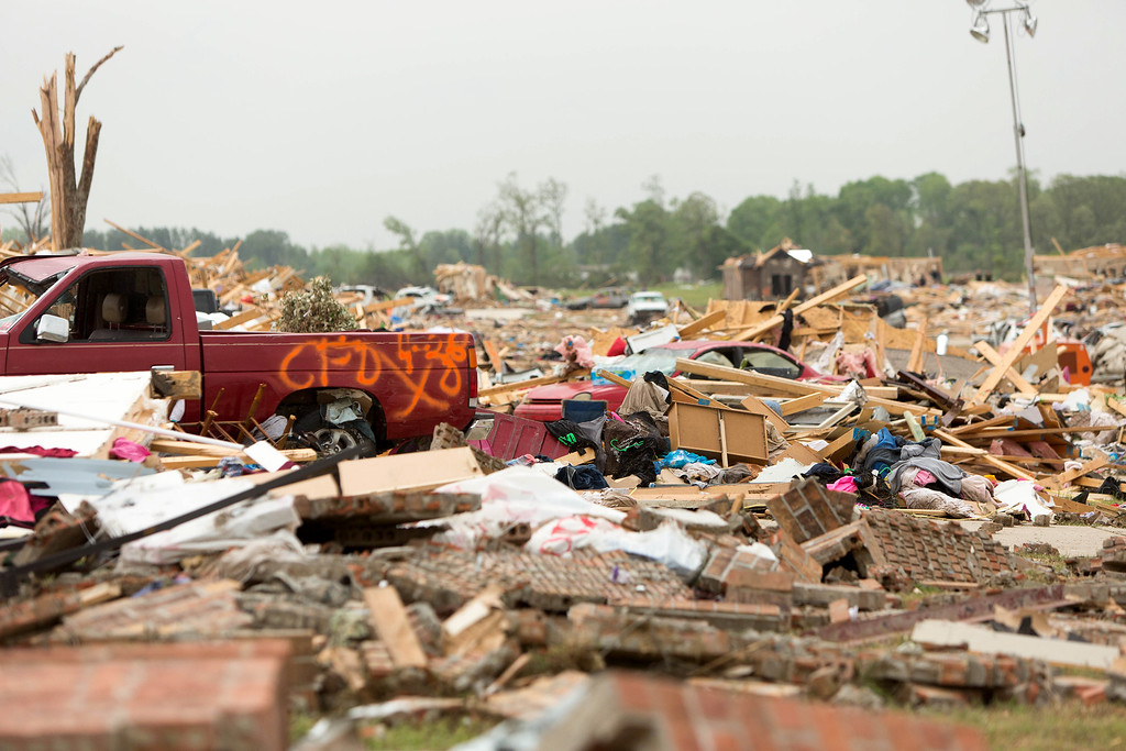 . Piles of cars and remnants of home are scattered along Cemetery Street in Vilonia, Ark., Monday, April 28, 2014, after a tornado struck the town late Sunday. (AP Photo/Karen E. Segrave)