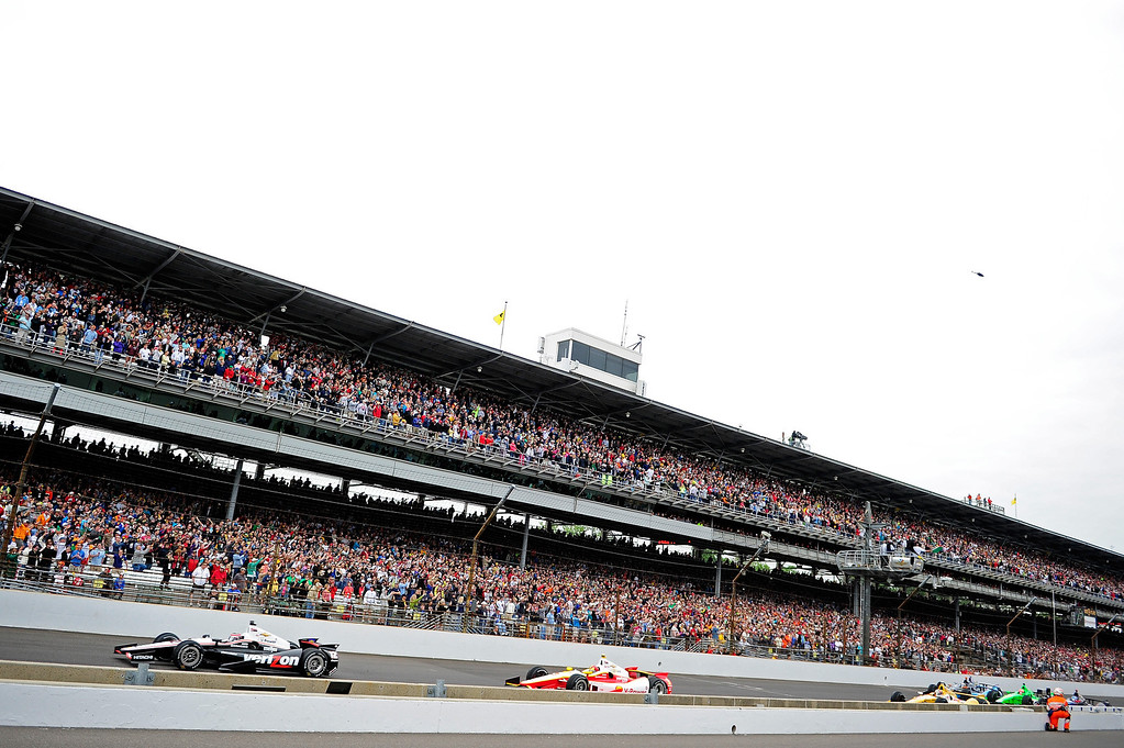 . Will Power of Australia, driver of the #12 Verizon Team Penske Chevrolet, leads cars down the frontstretch during the IZOD IndyCar Series 97th running of the Indianpolis 500 mile race at the Indianapolis Motor Speedway on May 26, 2013 in Indianapolis, Indiana.  (Photo by Robert Laberge/Getty Images)