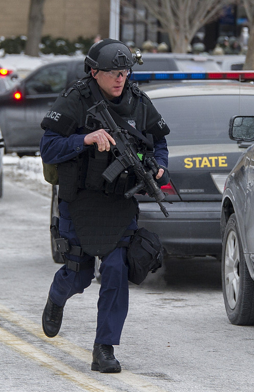 """. Maryland State Police patrol the Columbia Mall after a fatal shooting on January 25, 2014, in Columbia, Maryland. Three people were killed in a shooting at the popular shopping mall, located about 45 minutes outside Washington, authorities said Saturday. Howard County, Maryland, Police announced the fatalities and urged people inside the Mall \""""to stay in place.\""""Police said one of the dead was \""""located near gun and ammunition.\""""     AFP PHOTO / Jim WATSON/AFP/Getty Images"""