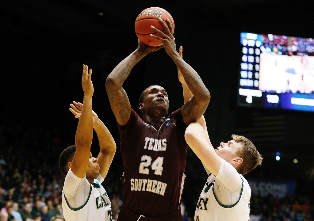 . Aaric Murray #24 of the Texas Southern Tigers goes up for a shot as Kyle Odister #35 and Zach Gordon #44 of the Cal Poly Mustangs defend during the first round of the 2014 NCAA Men\'s Basketball Tournament at UD Arena on March 19, 2014 in Dayton, Ohio.  (Photo by Gregory Shamus/Getty Images)