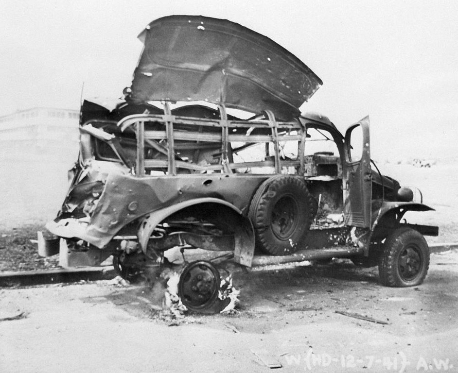 . A bombed U.S. Army truck with wheel still ablaze after the surprise attack, Dec. 7, 1941, which touched off a new war in the Pacific. (AP Photo)