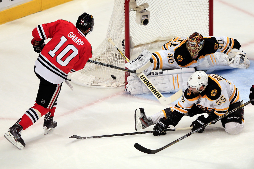 . CHICAGO, IL - JUNE 22:  Patrick Sharp #10 of the Chicago Blackhawks takes a shot against Tuukka Rask #40 of the Boston Bruins in Game Five of the 2013 NHL Stanley Cup Final at United Center on June 22, 2013 in Chicago, Illinois.  (Photo by Jamie Squire/Getty Images)