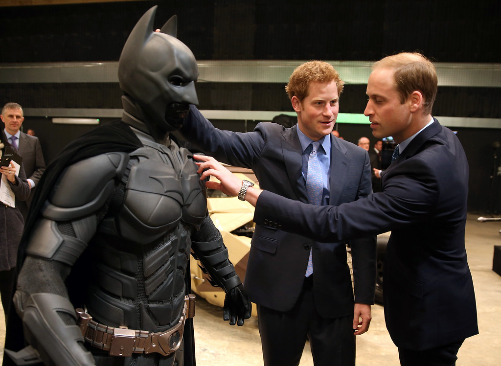 """. Britain\'s Prince William, right, and his brother Prince Harry look at a \'Batsuit\' used in the Batman films as they and Kate the Duchess of Cambridge, not pictured, attend the inauguration of \""""Warner Bros. Studios Leavesden\"""" near Watford, approximately 18 miles north west of central London, Friday, April 26, 2013. (AP Photo/Chris Jackson, Pool)"""