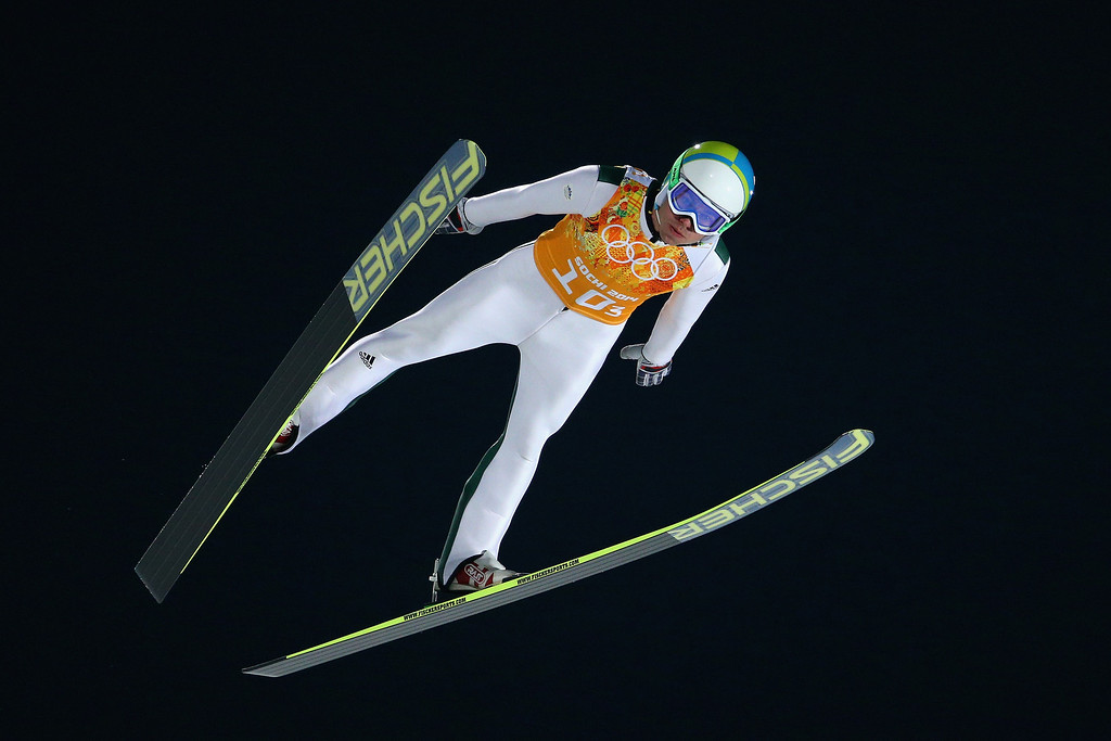 . Jernej Damjan of Slovenia jumps during the Men\'s Team Ski Jumping trial on day 10 of the Sochi 2014 Winter Olympics at the RusSki Gorki Ski Jumping Center on February 17, 2014 in Sochi, Russia.  (Photo by Paul Gilham/Getty Images)