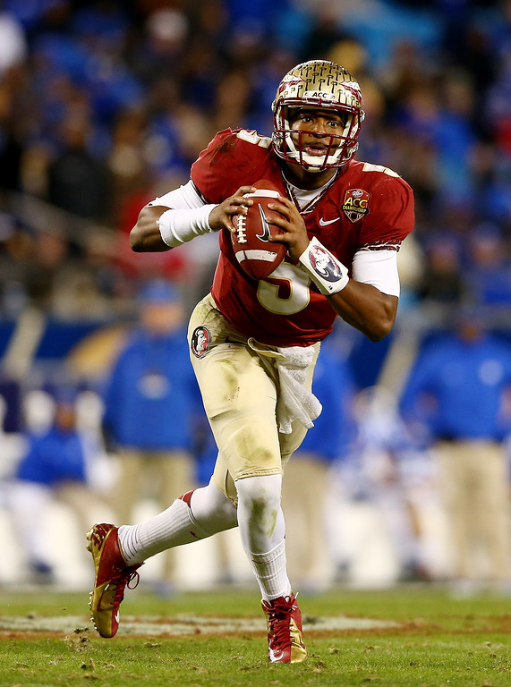 . Quarterback Jameis Winston #5 of the Florida State Seminoles looks to pass against the Duke Blue Devils during the ACC Championship game at Bank of America Stadium on December 7, 2013 in Charlotte, North Carolina.  (Photo by Streeter Lecka/Getty Images)