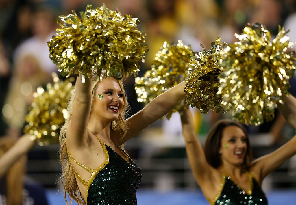 . GLENDALE, AZ - JANUARY 01:  A Baylor Bears cheerleader performs during the Tostitos Fiesta Bowl against the UCF Knights at University of Phoenix Stadium on January 1, 2014 in Glendale, Arizona.  (Photo by Ronald Martinez/Getty Images)
