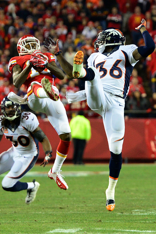 . KANSAS CITY, MO - DECEMBER 01: A.J. Jenkins (15) of the Kansas City Chiefs makes a crucial first-down catch as Kayvon Webster (36) of the Denver Broncos defends during the second half of the Broncos\' 35-28 win at Arrowhead Stadium. The Denver Broncos visit the Kansas City Chiefs in an AFC West showdown. (Photo by AAron Ontiveroz/The Denver Post)