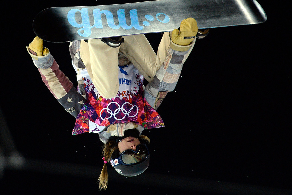 . Kaitlyn Farrington of the U.S. makes a run during a women\'s snowboard halfpipe final at the Rosa Khutor Extreme Park. Sochi 2014 Winter Olympics on Wednesday, February 12, 2014. (Photo by AAron Ontiveroz/The Denver Post)