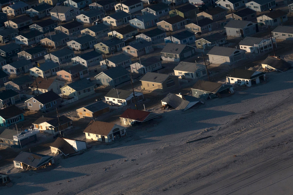. Houses are seen surrounded by sand in this aerial view near Ortley Beach, New Jersey,  almost a month after the area was hit by Hurricane Sandy, November 28, 2012.   REUTERS/Adrees Latif