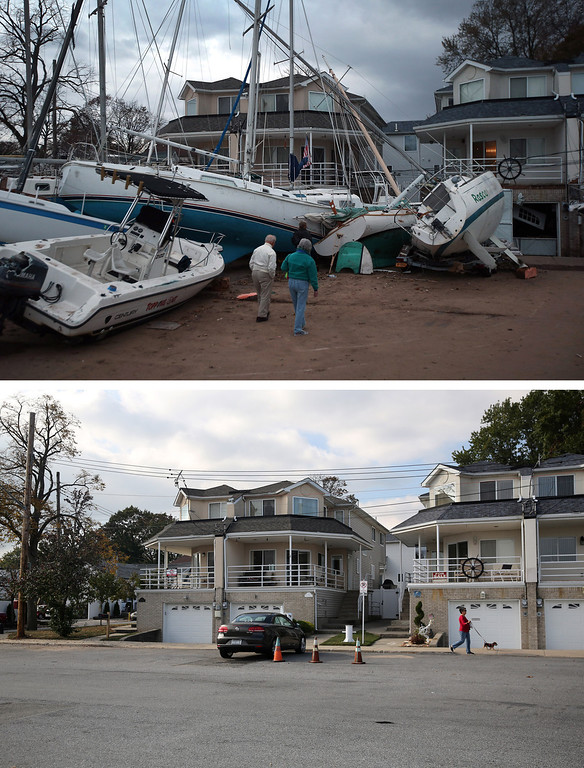 . NEW YORK, NY - NOVEMBER 02: (top) Boats pushed up by Hurricane Sandy lie against residences near a marina on November 2, 2012 in the Staten Island borough of New York City. NEW YORK, NY - OCTOBER 17:  (bottom) A woman walks her dog near a marina on October 17, 2013 in the Staten Island borough of New York City. Hurricane Sandy made landfall on October 29, 2012 near Brigantine, New Jersey and affected 24 states from Florida to Maine and cost the country an estimated $65 billion.   (Photos by John Moore/Getty Images)