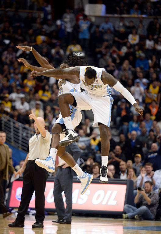 . DENVER, CO - NOVEMBER 13: Denver Nuggets power forward Kenneth Faried (35) and Denver Nuggets power forward J.J. Hickson (7) celebrate a dunk by Hickson during the second quarter against the Los Angeles Lakers November 13, 2013 at Pepsi Center. (Photo by John Leyba/The Denver Post)