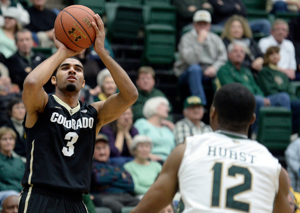 . University of Colorado\'s Xavier Talton shoots a three-pointer in front of Carlton Hurst during an NCAA game against Colorado State University on Tuesday, Dec. 3, 2013, at the Moby Arena in Fort Collins.