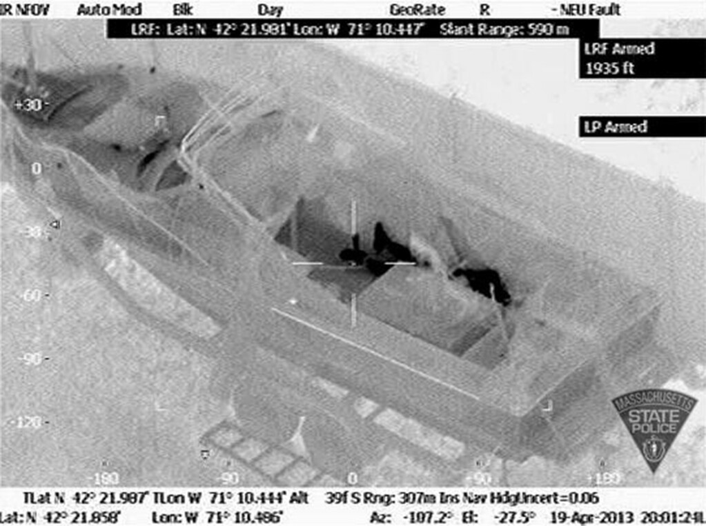 . FILE - This Friday, April 19, 2013 image made available by the Massachusetts State Police shows 19-year-old Boston Marathon bombing suspect, Dzhokhar Tsarnaev, hiding inside a boat during a search for him in Watertown, Mass. He was pulled, wounded and bloody, from the boat parked in the backyard of a home in the Greater Boston area. (AP Photo/Massachusetts State Police)